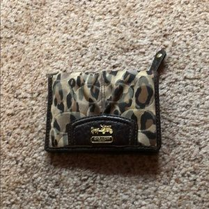 Little Coach wallet.
